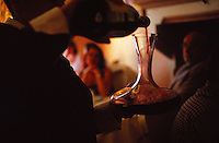 decanting red wine in a French restaurant