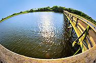 Fisheye lens view of fishing dock in marshland bay at Levy Park and Preserve, Merrick, Long Island, New York, summer 2011
