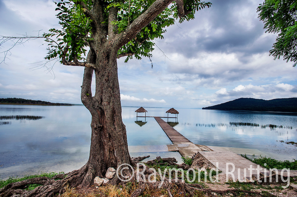 Guatemala - Lake Peten Itza between Flores and Tikal. Lake Petén Itzá  is a lake in the northern Petén Department in Guatemala. It is the second largest lake in Guatemala.A crocodile-shaped mountain on the right . photo raymond rutting