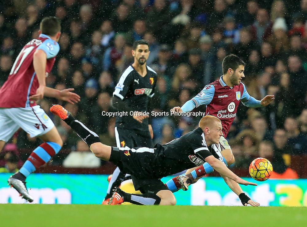 28th November 2015 - Barclays Premier League - Aston Villa v Watford -  Ben Watson of Watford stumbles as he tries to play the ball - Photo: Paul Roberts / Offside.