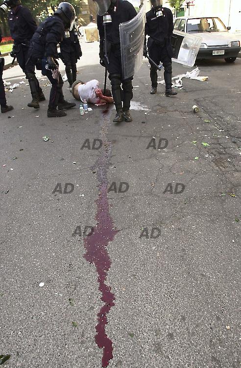 Carabinieri checking an injured protester