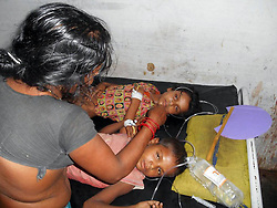 60141098  <br /> Children receive medical treatment at a hospital in Chapra district of eastern Indian state of Bihar, July 16, 2013. At least 21 children, all below 12 years, are now confirmed dead due to food poisoning after eating a free mid-day school meal in the eastern Indian state of Bihar Tuesday, a senior police official said Wednesday, India,<br /> Tuesday, 16th July 2013<br /> Picture by imago / i-Images<br /> UK ONLY