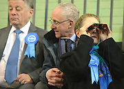 © Licensed to London News Pictures. 01/03/2013. Eastleigh, UK A woman wearing a Conservative Party rosette watches the count through binoculars. Campaigning in the weeks ahead of The Liberal Democrats winning the Eastleigh by-election, with the UK Independence Party pushing the Conservatives into third place.. Photo credit : Stephen Simpson/LNP