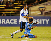 Montreal Impact midfielder Davy Arnaud (22) pushes San Jose Earthquakes midfielder Rafael Baca (30) to the ground in the second half of the game at Buck Shaw Stadium in Santa Clara, California, on September 17, 2013.  The San Jose Earthquakes beat Montreal Impact 3-0. (Stan Olszewski/QMI Agency)