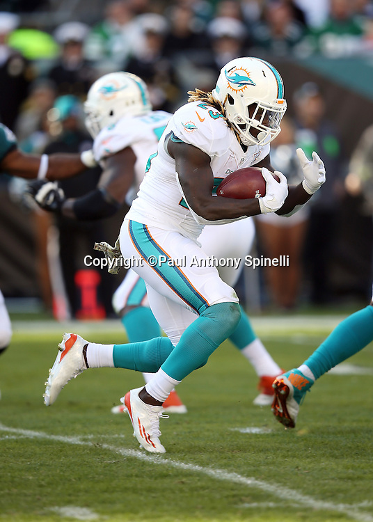 Miami Dolphins running back Jay Ajayi (23) runs the ball during the 2015 week 10 regular season NFL football game against the Philadelphia Eagles on Sunday, Nov. 15, 2015 in Philadelphia. The Dolphins won the game 20-19. (©Paul Anthony Spinelli)