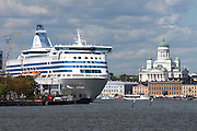 Boat excursion to the surrounding islands. A Silja (Seal) Line ferry next to Kauppatori (Market Square) at the city center, the lutheran Cathedral in the background.