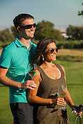 A couple wine tasting and playing golf at Three Rivers Winery