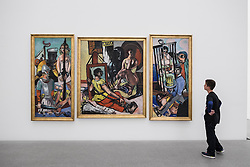 "Boy looking at painting by Max Beckmann "" Versuchung"" at Pinakothek Museum in Munich Germany"