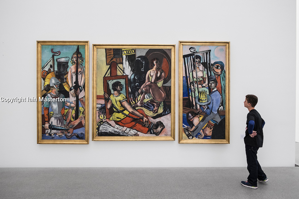 """Boy looking at painting by Max Beckmann """" Versuchung"""" at Pinakothek Museum in Munich Germany"""