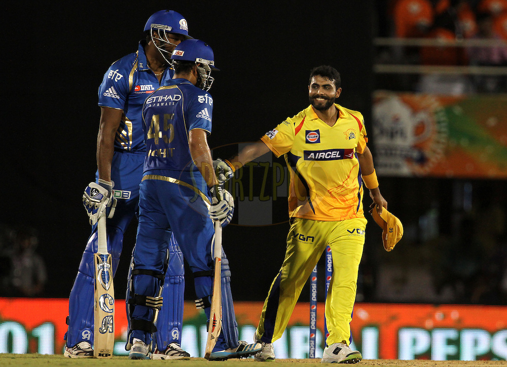 Rohit Sharma captain of the Mumbai Indians and Ravindra Jadeja of The Chennai Superkings share a joke during the eliminator match of the Pepsi Indian Premier League Season 2014 between the Chennai Superkings and the Mumbai Indians held at the Brabourne Stadium, Mumbai, India on the 28th May  2014<br /> <br /> Photo by Vipin Pawar / IPL / SPORTZPICS<br /> <br /> <br /> <br /> Image use subject to terms and conditions which can be found here:  http://sportzpics.photoshelter.com/gallery/Pepsi-IPL-Image-terms-and-conditions/G00004VW1IVJ.gB0/C0000TScjhBM6ikg