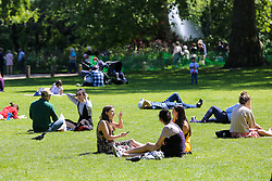© Licensed to London News Pictures. 14/05/2019. London, UK. People enjoy warm weather in London's St James's Park. Temperatures are set to reach 19C in the capital and potentially higher in the some parts of the UK. Photo credit: Dinendra Haria/LNP