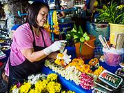 07 NOVEMBER 2017 - BANGKOK, THAILAND: Selling flower garlands at a local market on Ekkamai Soi 30 in Bangkok.      PHOTO BY JACK KURTZ