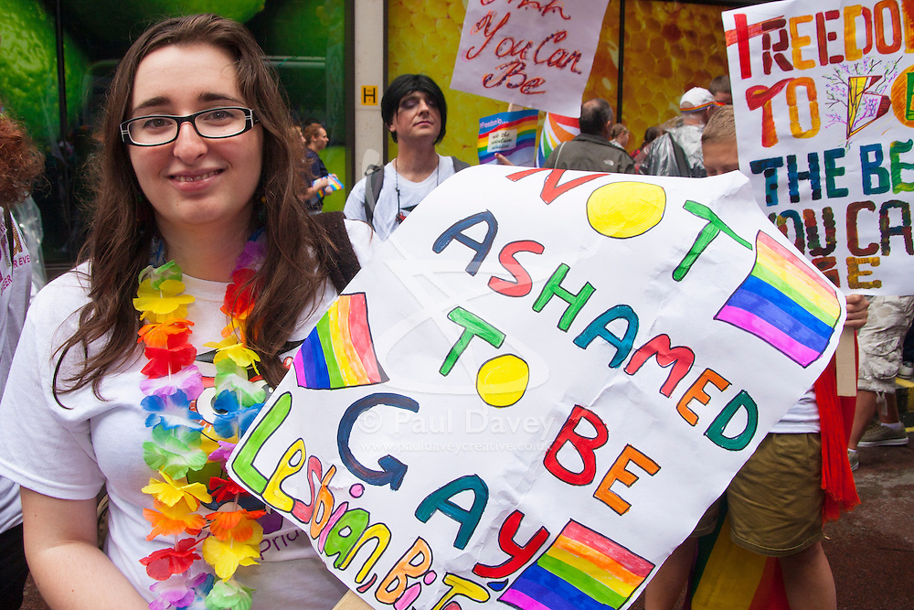 London, June 28th 2014. A woman poses with her homemade poster as Gay Pride revellers assemble on Baker Street ahead of the parade.