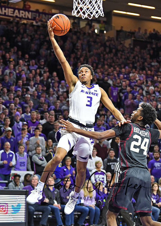 MANHATTAN, KS - MARCH 09:  Kamau Stokes #3 of the Kansas State Wildcats drives in for a basket against Jamal Bieniemy #24 of the Oklahoma Sooners during the second half against on March 9, 2019 at Bramlage Coliseum in Manhattan, Kansas.  (Photo by Peter G. Aiken/Getty Images) *** Local Caption *** Kamau Stokes; Jamal Bieniemy