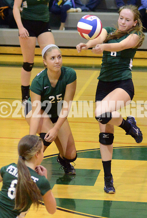 PERKASIE, PA - OCTOBER 23: Pennridge's Lauren<br /> Drugotch #25 and Ana Vitantonio #8 (bottom) watch as the ball slips past Meghan Keefe #6 during a district one volleyball playoff game against Upper Dublin at Pennridge High School October 23, 2014 Perkasie, Pennsylvania. (Photo by William Thomas Cain/Cain Images)