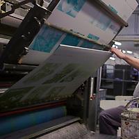 Final edition of the Hungarian photo magazine Fotos Szem (Photographer Eye) undergoes the process of printing at the Pauker printing company in Budapest, Hungary. Wednesday, 13. January 2010. ATTILA VOLGYI
