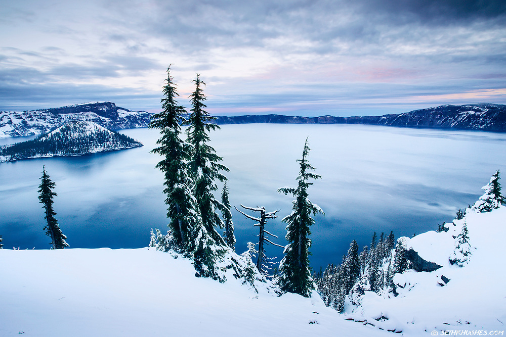 A view of Crater Lake in the wintertime with freshly fallen snow around the caldera rim.