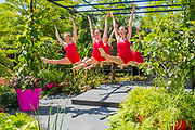Mersey Girls, known for their appearance on ITV Britain's Got Talent 2017, dance on The B&Q Bursting Bizzie Lizzy garden by Matthew Childs - Press day at The RHS Hampton Court Flower Show.