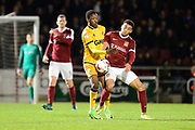 Northampton Town defender (on loan from Barnsley) Lewin Nyatanga (22) battles for possession with Port Vale Midfielder (on loan from Queens Park Rangers) Olamide Shodipo (46) during the EFL Sky Bet League 1 match between Northampton Town and Port Vale at Sixfields Stadium, Northampton, England on 14 March 2017. Photo by Dennis Goodwin.