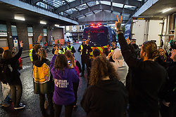 London, UK. 7 October, 2019. Animal rights activists from Extinction Rebellion show solidarity with a fellow activist arrested by City of London police officers at Smithfield meat market during the Animal Rebellion on the first day of International Rebellion protests to demand a government declaration of a climate and ecological emergency, a commitment to halting biodiversity loss and net zero carbon emissions by 2025 and for the government to create and be led by the decisions of a Citizens' Assembly on climate and ecological justice.