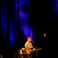Painted in stage light Bruce Springsteen perform in concert at the Paramount Theater in Asbury Park
