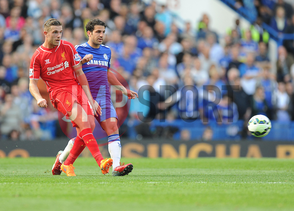 Liverpool's Jordan Henderson clears the ball from Chelsea's Cesc Fabregas - Photo mandatory by-line: Alex James/JMP - Mobile: 07966 386802 - 10/05/2015 - SPORT - Football - London - Stamford Bridge - Chelsea v Liverpool - Barclays Premier League