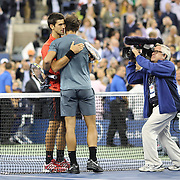 Rafael Nadal, Spain, is congratulated by Novak Djokovic, Serbia, after the Men's Singles Final at the US Open, Flushing. New York, USA. 9th September 2013. Photo Tim Clayton