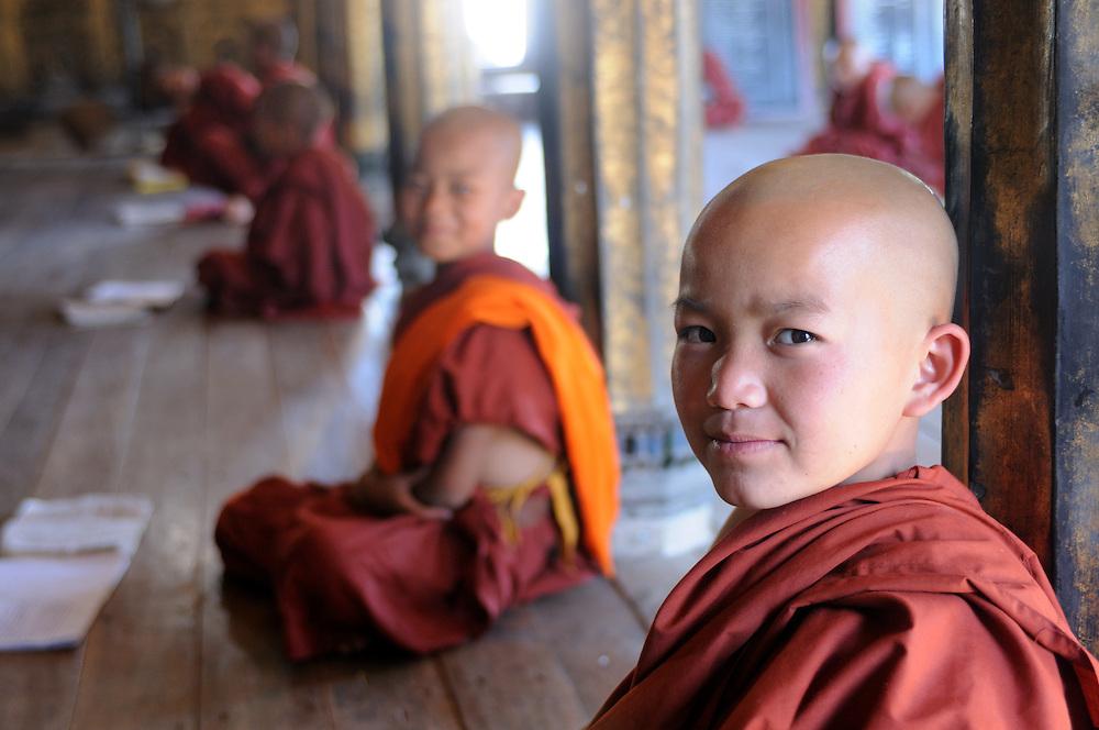 Monks in the wooden monastery of Shwe Yaunghwe Kyaung, Inole lake, Mynamar,Asia