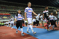 Football - Clint Hill of QPR leads the team as Captain during the friendly match against Kelantan Select XI during the QPR Asian Tour 2012 at the Shah Alam Stadium, Selangor, Malaysia