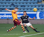 24th February 2018, Dens Park, Dundee, Scotland; Scottish Premier League football, Dundee versus Motherwell; Cammy Kerr of Dundee and Chris Cadden of Motherwell
