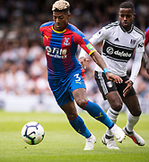 Patrick van Aanholt (3) of Crystal Palace, Fulham (3) Ryan Sessegnon during the Premier League match between Fulham and Crystal Palace at Craven Cottage, London, England on 11 August 2018.