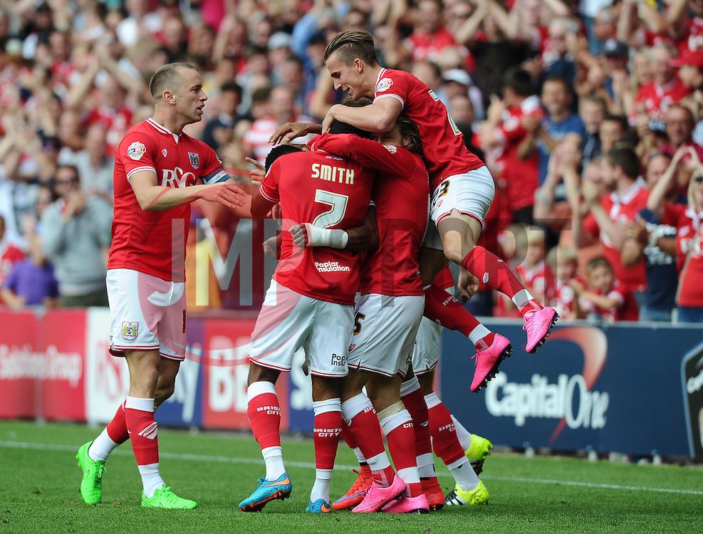 Jonathan Kodjia of Bristol City celebrates his goal with team mates  - Mandatory byline: Joe Meredith/JMP - 07966386802 - 15/08/2015 - FOOTBALL - Ashton Gate -Bristol,England - Bristol City v Brentford - Sky Bet Championship