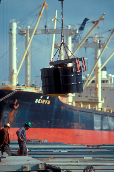 Barrels being lifted by a crane to load and unload