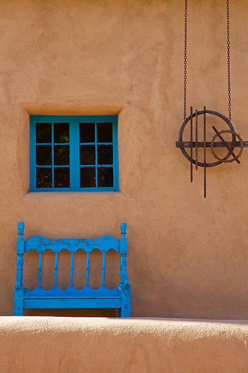 Turquoise blue trim adorns this Adobe art gallery on Canyon Road in Santa Fe, New Mexico.