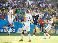 Karim Benzema of France has a shot which hits Mats Hummels of Germany (L) in the midriff during the 2014 FIFA World Cup match between France and Germany at the Maracana Stadium, Rio de Janeiro<br /> Picture by Andrew Tobin/Focus Images Ltd +44 7710 761829<br /> 04/07/2014