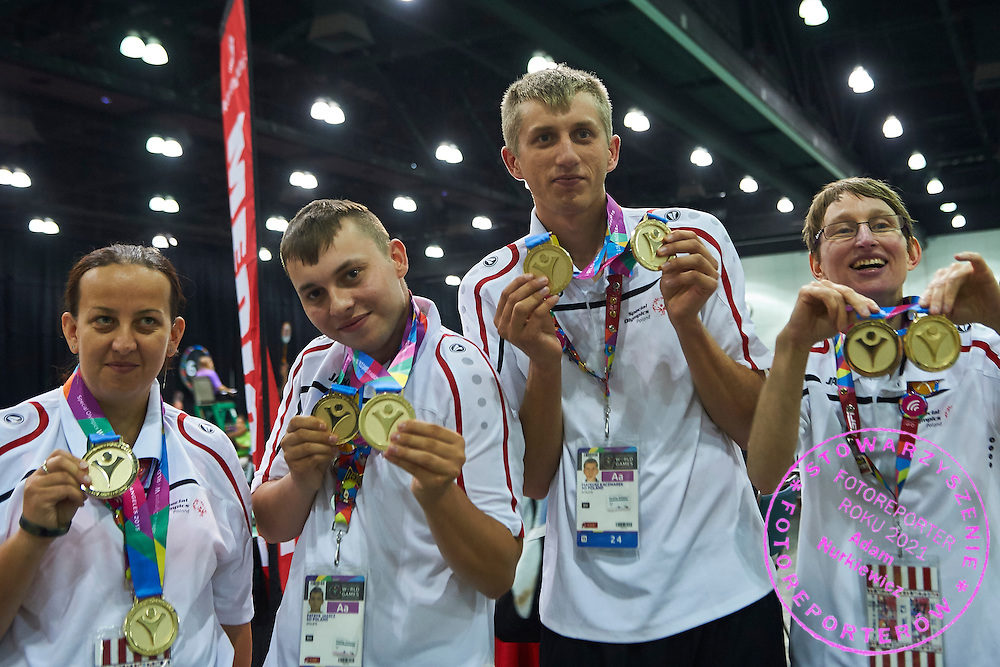 (L-R) SO Poland athletes Beata Boncol and Patryk Jaszcz and  Mateusz Kaczmarek and Teresa Cichy pose with gold medals after medal ceremony after bowling competition during fifth day of the Special Olympics World Games Los Angeles 2015 on July 29, 2015 at Los Angeles Convention Centre in Los Angeles, USA.<br /> <br /> USA, Los Angeles, July 29, 2015<br /> <br /> Picture also available in RAW (NEF) or TIFF format on special request.<br /> <br /> For editorial use only. Any commercial or promotional use requires permission.<br /> <br /> Adam Nurkiewicz declares that he has no rights to the image of people at the photographs of his authorship.<br /> <br /> Mandatory credit:<br /> Photo by &copy; Adam Nurkiewicz / Mediasport