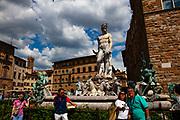 Tourists take a selfie at the Fontana del Nettuna, Fountain of Neptune, Piazza della Signoria, Florence, Italy
