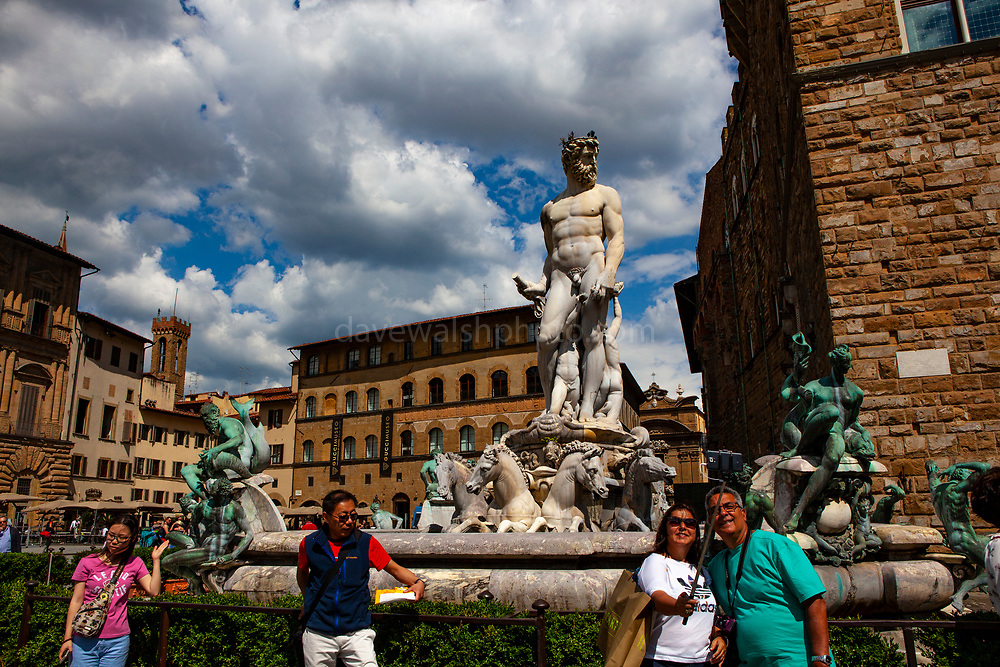 Tourists take a selfie at the Fontana del Nettuna, Fountain of Neptune, Piazza della Signoria, Florence, Italy