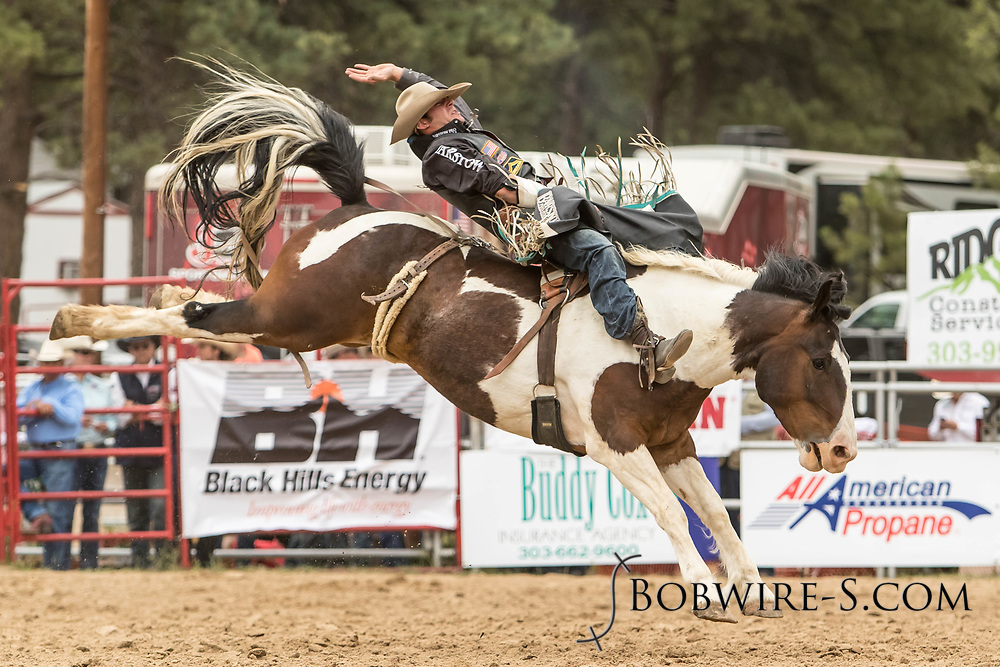 Bareback rider Austin Foss rides Summit Pro Rodeo's Indian Style during the third performance of the Elizabeth Stampede on Sunday, June 3, 2018.
