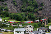 Bernina Express ascending on the circular viaduct at Brusio.