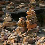 Rock pile offerings at Wat Mahathat in Sukhothai. The rocks are placed for good luck. The Sukhothai kingdom was an early Thai kingdom in north central Thailand. It existed from during the 13, 14, 15th centuries The.old capital is in ruins and is a Historical Park..View from Feb, 2007.