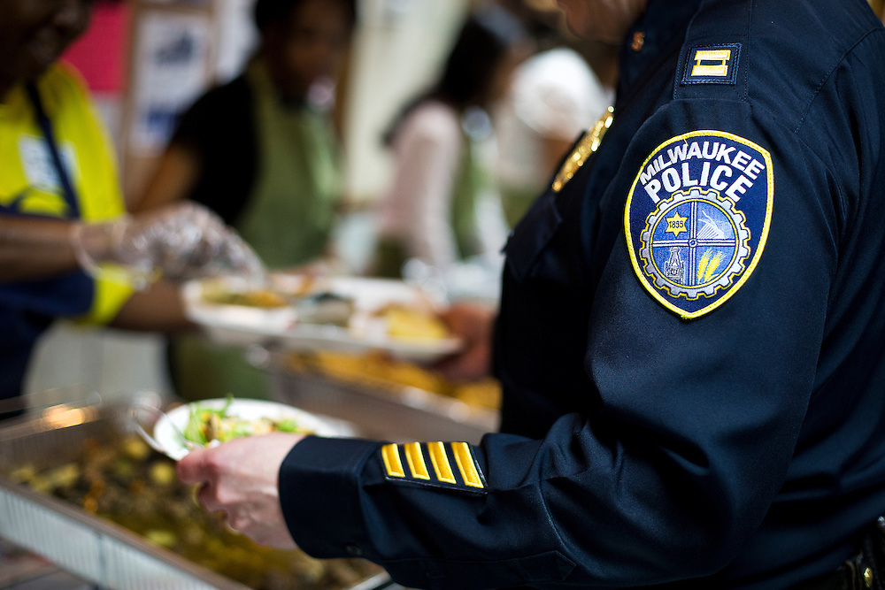 MILWAUKEE, WI – MARCH 28: Milwaukee Police Captain Timothy Heier receives a meal from community members at Grace Fellowship Church on Monday, March 28, 2016. Meier and nine other Milwaukee Police Department officers were in attendance for a Zeidler Center Police and Resident Discussion in the Harambee neighborhood.
