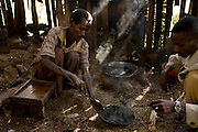 An Ethiopian man roasts coffee beans over an open fire during a local coffee ceremony February 23, 2007 in Fero, Ethiopia in the southern Sidamo coffee region. Ethiopia is the birthplace of arabica coffee, and the coffee ceremony, a process of roasting green coffee beans, grinding them, burning incense and joining together to share a cup that is a daily tradition for many Ethiopians.