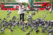 An elderly man feeding lentils from a plastic carrier bag to the pigeons on the green at Marble Arch,  Central London. United Kingdom. (photo by Andrew Aitchison / In pictures via Getty Images)