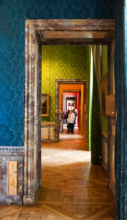 Tourists walk through rooms during a visit to the Chateau Versailles in Versailles, France.