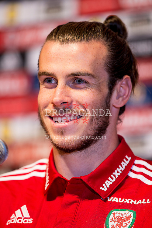 DINARD, FRANCE - Thursday, June 23, 2016: Wales' Gareth Bale during a press conference at their base in Dinard as they prepare for the Round of 16 match during the UEFA Euro 2016 Championship. (Pic by Paul Greenwood/Propaganda)