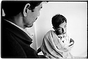 A 20 year old young man with facial trauma at the ICRC WWAP facility in Peshawar...Patients being treated at a field surgical hospital running the Weapon Wounded Assistance Project (WWAP) in Peshawar. The aim of the ICRC facility is to respond to weapon wounded patients from the ongoing conflict along the Pak-Afghan border area, including the tribal areas of North West Frontier Province (NWFP) and Federally Administered Tribal Areas (FATA)...The goal of the surgical hospital is to provide substantial and relevant surgical assistance according to needs by providing a surgical facility specialising in the treatment of weapon wounded patients within ICRC war surgical protocols.