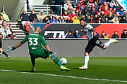 Niki Maenpaa (33) of Bristol City makes a save from a shot at goal by Bradley Johnson (15) of Derby County during the EFL Sky Bet Championship match between Bristol City and Derby County at Ashton Gate, Bristol, England on 27 April 2019.