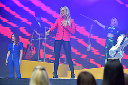 Louisa Johnson and Clean Bandit during Capital's Summertime Ball with Vodafone at Wembley Stadium, London. This summer's hottest artists performed live for 80,000 Capital listeners at Wembley Stadium at the UK's biggest summer party. Performers included Camila Cabello, Shawn Mendes, Rita Ora, Charlie Puth, Jess Glyne, Craig David, Anne-Marie, Rudimental, Sean Paul, Clean Bandit, James Arthur, Sigala, Years & Years, Jax Jones, Raye, Jonas Blue, Mabel, Stefflon Don, Yungen and G-Eazy