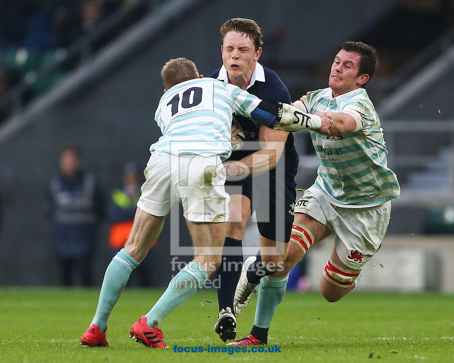 Tom Stileman of Oxford University is tackled by Fraser Gillies of Cambridge University during The Varsity Match at Twickenham Stadium, Twickenham<br /> Picture by Mark Chappell/Focus Images Ltd +44 77927 63340<br /> 08/12/2016